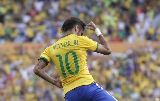Brazil's Neymar celebrates after scoring against Panama during a friendly soccer match at the Serra Dourada stadium in Goiania, Brazil, Tuesday, June 3, 2014. (AP Photo/Andre Penner)