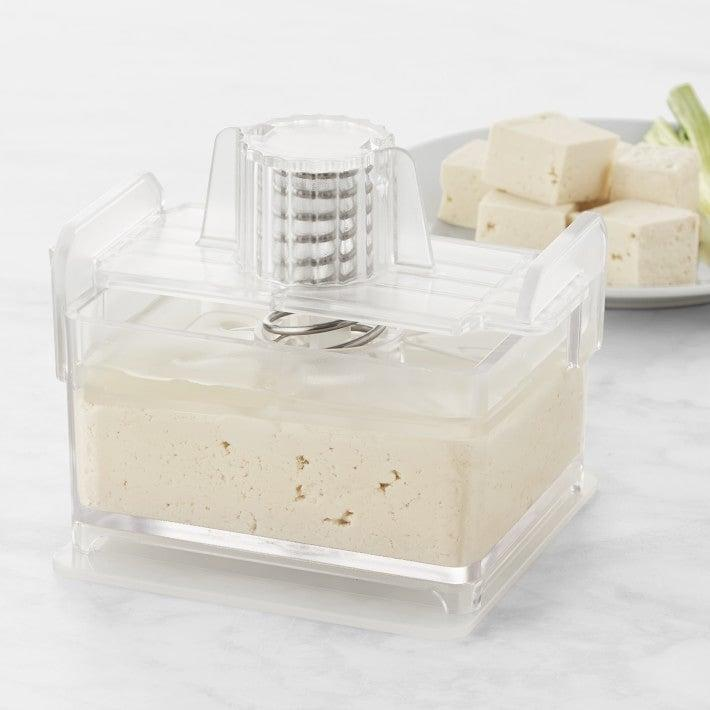 "<h2>Tofu Press</h2><br>Do we even have to say why this kitchen appliance is essential vegan-gifting material?<br><br><strong><em><a href=""https://www.williams-sonoma.com/shop/cooks-tools/vegetable-tools/"" rel=""nofollow noopener"" target=""_blank"" data-ylk=""slk:Shop Williams-Sonoma"" class=""link rapid-noclick-resp"">Shop Williams-Sonoma</a></em></strong> <br><br><strong>Williams-Sonoma</strong> Tofu Press, $, available at <a href=""https://go.skimresources.com/?id=30283X879131&url=https%3A%2F%2Fwww.williams-sonoma.com%2Fproducts%2Ftofu-press%2F%3F"" rel=""nofollow noopener"" target=""_blank"" data-ylk=""slk:Williams-Sonoma"" class=""link rapid-noclick-resp"">Williams-Sonoma</a>"