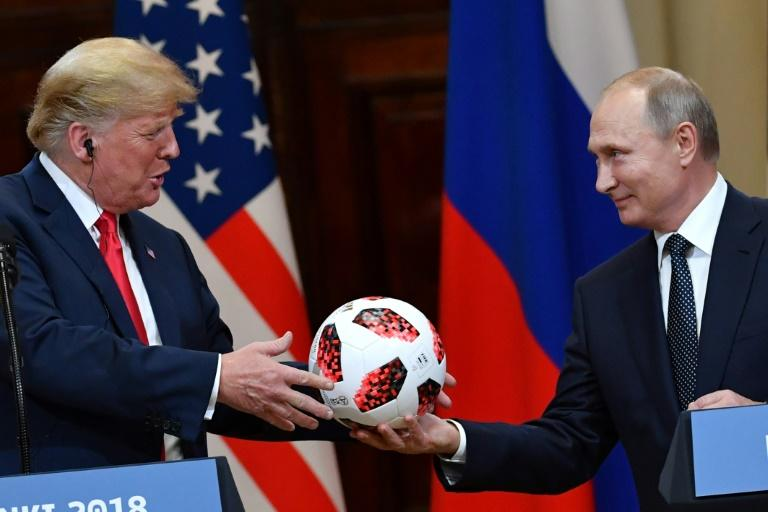 Suspicion towards Donald Trump (L, pictured 2018) stems from his campaign trail promise to improve relations with Russian President Vladimir Putin (AFP Photo/Yuri KADOBNOV)