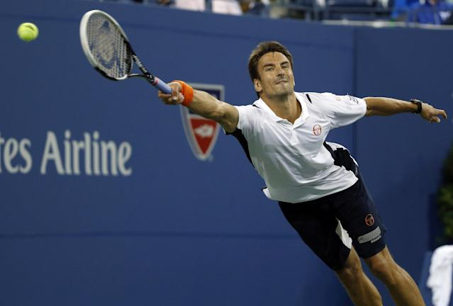Tommy Robredo, of Spain, lunges for but can't reach a shot by Nick Kyrgios, of Australia, in their third-round match at the U.S. Open tennis tournament, Saturday, Aug. 30, 2014, in New York. (AP Photo/Elise Amendola)