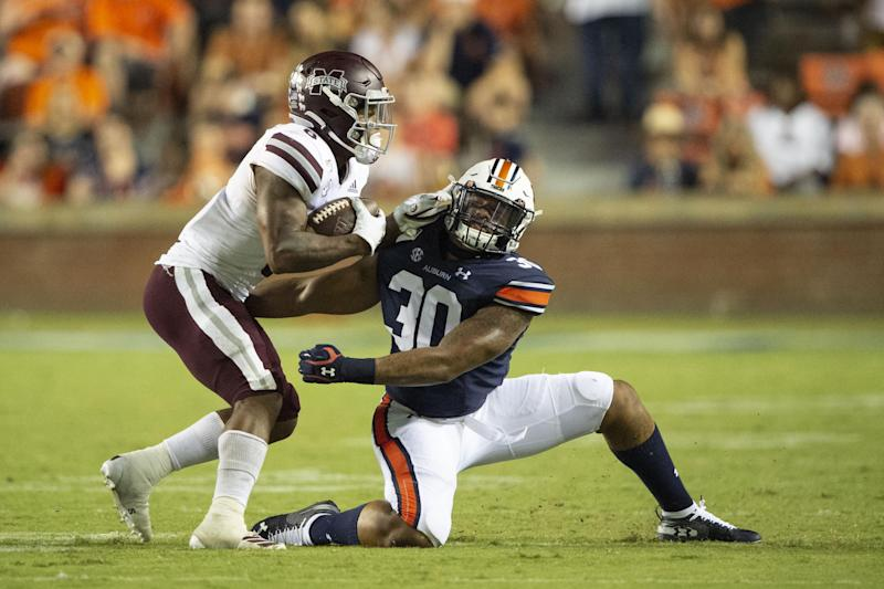 AUBURN, AL - SEPTEMBER 28: Linebacker Michael Harris #30 of the Auburn Tigers looks to tackle running back Kylin Hill #8 of the Mississippi State Bulldogs during the fourth quarter at Jordan-Hare Stadium on September 28, 2019 in Auburn, AL. (Photo by Michael Chang/Getty Images)