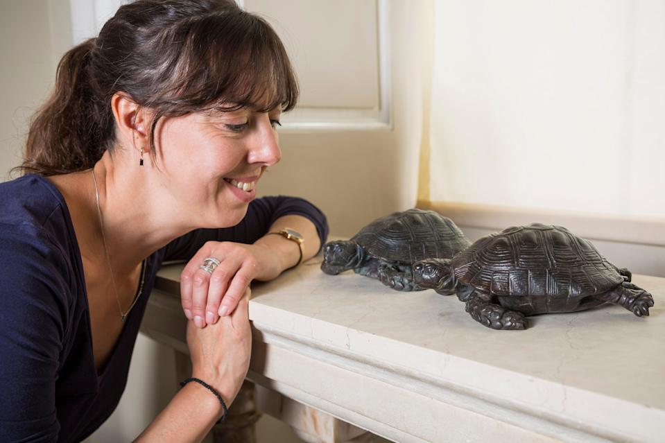 Property curator Elena Greer in the entrance hall at Kingston Lacy, Dorset, with the recovered bronze tortoises (James Dobson/National Trust/PA)