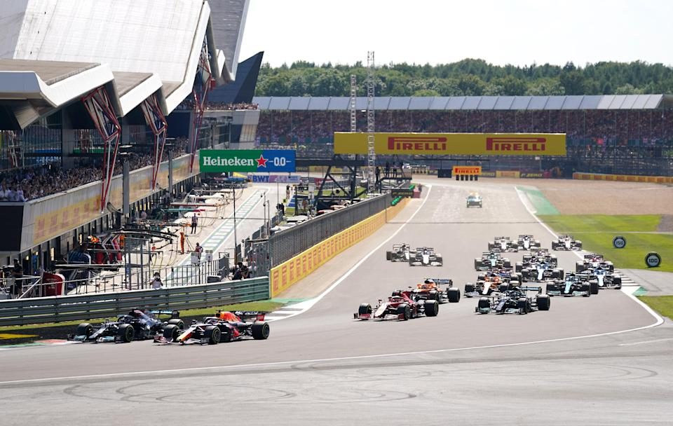 Mercedes' Lewis Hamilton and Red Bull Racing's Max Verstappen lead the race at the start of the race during the British Grand Prix at Silverstone, Towcester. Picture Date: Sunday July 18, 2021. (PA Wire)