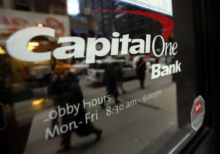 People walk past a Capital One banking center in New York's financial district