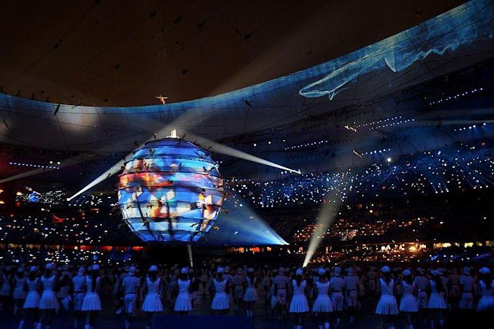 <p>A brilliantly choreographed opening ceremony features 2008 drummers in perfect synchronization. Controversy does erupt days later when its discovered 9-year old Lin Miaoke lip-synced the pre-recorded voice of Yang Peiyi.</p>