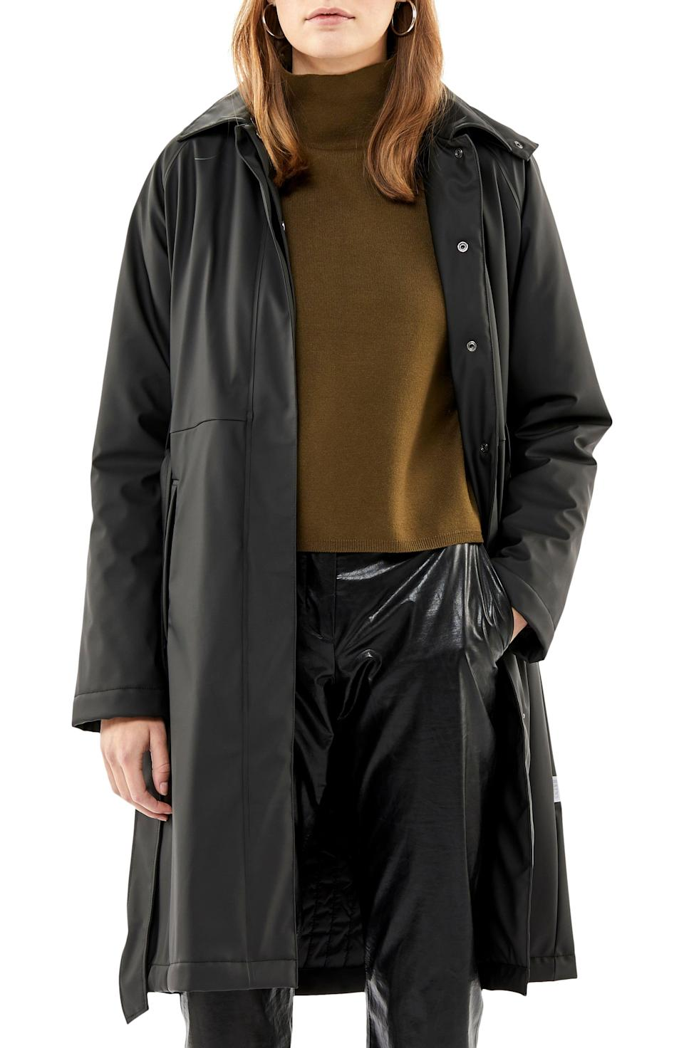 """<p><strong>RAINS</strong></p><p>nordstrom.com</p><p><strong>$120.00</strong></p><p><a href=""""https://go.redirectingat.com?id=74968X1596630&url=https%3A%2F%2Fshop.nordstrom.com%2Fs%2Frains-waterproof-trench-coat-with-detectable-hood%2F5354003&sref=https%3A%2F%2Fwww.cosmopolitan.com%2Fstyle-beauty%2Ffashion%2Fg32950282%2Fcute-rainy-day-outfit-ideas%2F"""" rel=""""nofollow noopener"""" target=""""_blank"""" data-ylk=""""slk:Shop Now"""" class=""""link rapid-noclick-resp"""">Shop Now</a></p><p>A classic long black raincoat always looks good. Wear it over a knit sweater and shiny patent leather pants for a subtle yet standout look. </p>"""