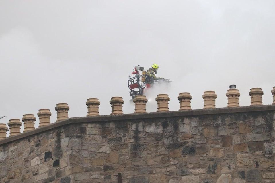 Firefighters used specialised equipment on the roof of the building (Matt Donlan/PA)