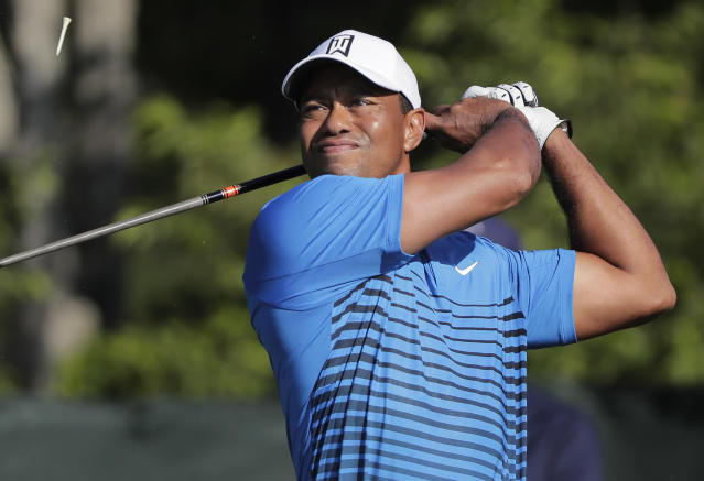 Tiger Woods tees off the fourth hole during a practice round for the U.S. Open Golf Championship, Tuesday, June 12, 2018, in Southampton, N.Y. (AP)