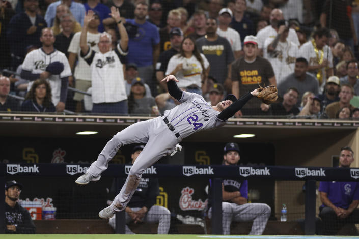 Colorado Rockies third baseman Ryan McMahon makes a catch in foul territory on a ball hit by San Diego Padres' Wil Myers in the fourth inning of a baseball game Friday, July 30, 2021, in San Diego. (AP Photo/Derrick Tuskan)
