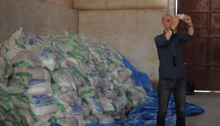Jeremy Courtney, founder of PLC, shoots a fundraising video in the Qayyara warehouse. (Photo: Ash Gallagher for Yahoo News)