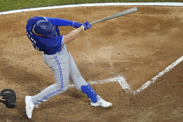 Toronto Blue Jays' Riley Adams doubles off Chicago White Sox starting pitcher Carlos Rodon during the fifth inning of a baseball game Tuesday, June 8, 2021, in Chicago, Adams' first hit in the majors. (AP Photo/Charles Rex Arbogast)