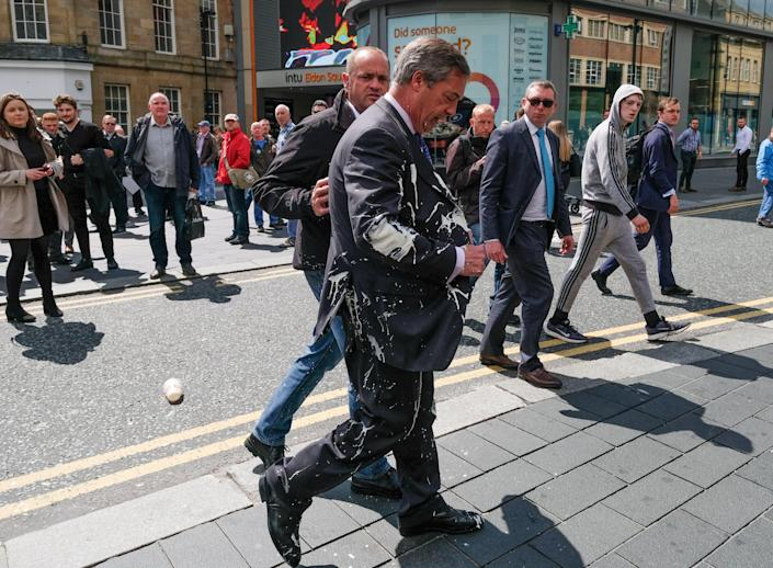 Brexit Party leader Nigel Farage has what is thought to have been a milkshake thrown over him as he visits Northumberland Street in Newcastle Upon Tyne during a whistle stop U.K. tour on May 20, 2019. (Photo: Ian Forsyth/Getty Images)