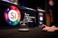 A replica of the International Prototype Kilogram is pictured is seen at the 26th meeting of the General Conference on Weights and Measures (CGPM) to vote on the redefinition of four base units of the International System of Units (SI) in Versailles, France, November 16, 2018. REUTERS/Benoit Tessier