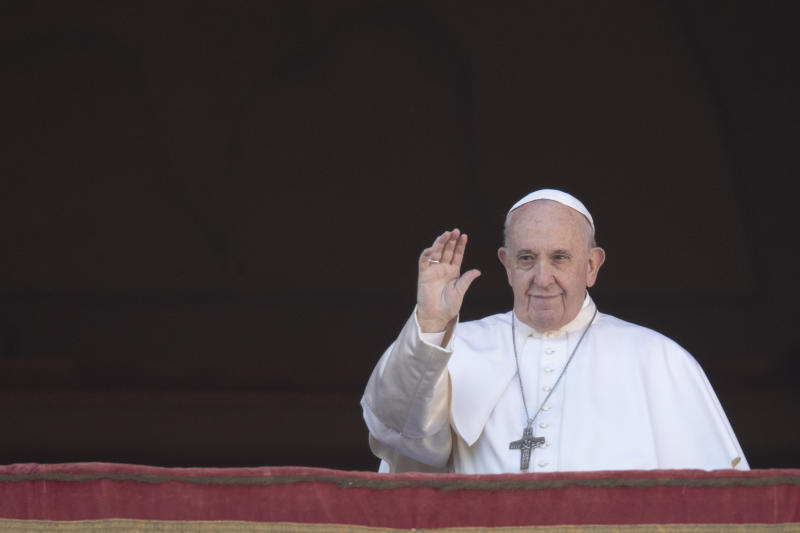 Pope Francis waves to faithful as he arrives to deliver the Urbi et Orbi (Latin for 'to the city and to the world' ) Christmas' day blessing from the main balcony of St. Peter's Basilica at the Vatican, Wednesday, Dec. 25, 2019. (AP Photo/Alessandra Tarantino)