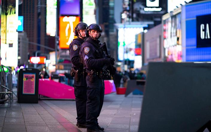 NYPD officers stand guard after two women and a four-year-old girl were injuring by gun fire in Times Square, New York - AFP