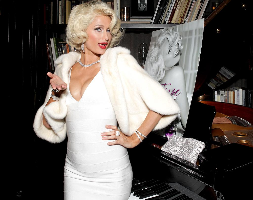 """Paris Hilton obviously thinks a lot of herself, and she thinks so much of Monroe that she'd put herself in the same category! She dressed like Monroe in the """"Diamonds Are a Girl's Best Friend"""" number for the premiere of Hilton's movie """"The Hottie and the Nottie"""" in 2008. Two years later, the hotel heiress donned a curve-hugging white dress, faux fur, diamonds, and retro hair and makeup as a nod to the actress at the launch of her Tease perfume inspired by Monroe. """"I have loved [Monroe] ever since I was a little girl,"""" Paris said at the time. """"I just thought she was the most beautiful woman, the camera loved her, and onscreen she was like no one else. Calling her a tease was something fun, because she was such a flirt."""" She opened up more about her admiration for the screen goddess in an interview with the U.K.'s <em>Sunday Times</em>. """"I think every decade has an iconic blonde - like Marilyn Monroe or Princess Diana - and right now, I'm that icon."""" Hmm, but it's not likely people will remember """"The Hottie and the Nottie"""" in 50 years!"""