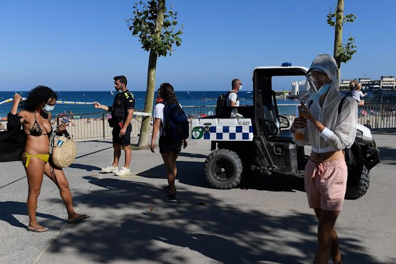 Large crowds at Spanish beaches forced police to shut them down.