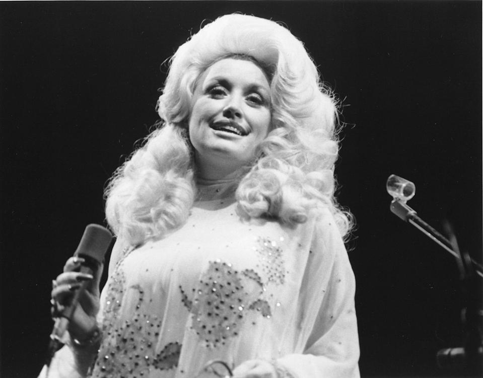 "<p>Dolly Parton isn't just a hugely popular country music star — she's an institution. Her first album, <a href=""https://www.amazon.com/Hello-Im-Dolly-Parton/dp/B018J7YLJG"" rel=""nofollow noopener"" target=""_blank"" data-ylk=""slk:Hello, I'm Dolly"" class=""link rapid-noclick-resp""><em>Hello, I'm Dolly</em></a> came out in 1967, and she's been breaking records and winning awards ever since. Parton has topped the Billboard charts 25 times, earning 25 Recording Industry Association of America-certified gold, platinum and multi-platinum awards. Over her career, she's earned 41 top-10 country albums, 110 charted singles, nine Grammy Awards (of 47 nominations), two <a href=""https://www.goodhousekeeping.com/life/entertainment/g5132/academy-awards-oscars-history/"" rel=""nofollow noopener"" target=""_blank"" data-ylk=""slk:Academy Award"" class=""link rapid-noclick-resp"">Academy Award</a> nominations, 10 Country Music Association Awards, seven Academy of Country Music Awards, three American Music Awards, and the Country Music Association's Entertainer of the Year Award. She's also a member of the Country Music Hall of Fame. </p><p>You probably know her music, but Parton has a very private personal life. Born in 1946 the fourth of 12 siblings, her first home was a one-room cabin in East Tennessee. She and her <a href=""https://www.goodhousekeeping.com/life/entertainment/a29858376/dolly-parton-carl-dean-judy-ogle-interview/"" rel=""nofollow noopener"" target=""_blank"" data-ylk=""slk:husband Carl Thomas Dean"" class=""link rapid-noclick-resp"">husband Carl Thomas Dean</a> have been married for more than 50 years, although he rarely accompanies her in public. While she doesn't have any biological children, she helped raise several of Dean's siblings. Dolly is also <a href=""https://www.goodhousekeeping.com/life/entertainment/a30430863/dolly-parton-miley-cyrus-related/"" rel=""nofollow noopener"" target=""_blank"" data-ylk=""slk:Miley Cyrus's &quot;fairy&quot; godmother"" class=""link rapid-noclick-resp"">Miley Cyrus's ""fairy"" godmother</a>, not to mention the godmother of country music in general. Take a trip down memory lane with a look back at the life and times of Dolly Parton. </p>"