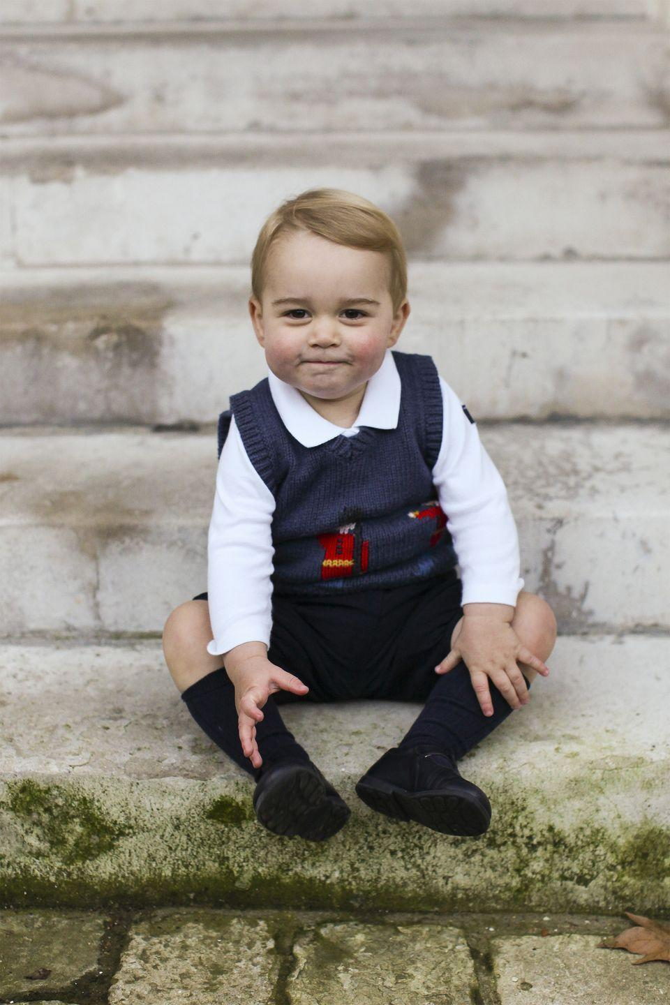 <p>Prince George sits for his first official set of Christmas portraits in a courtyard at Kensington Palace.</p>
