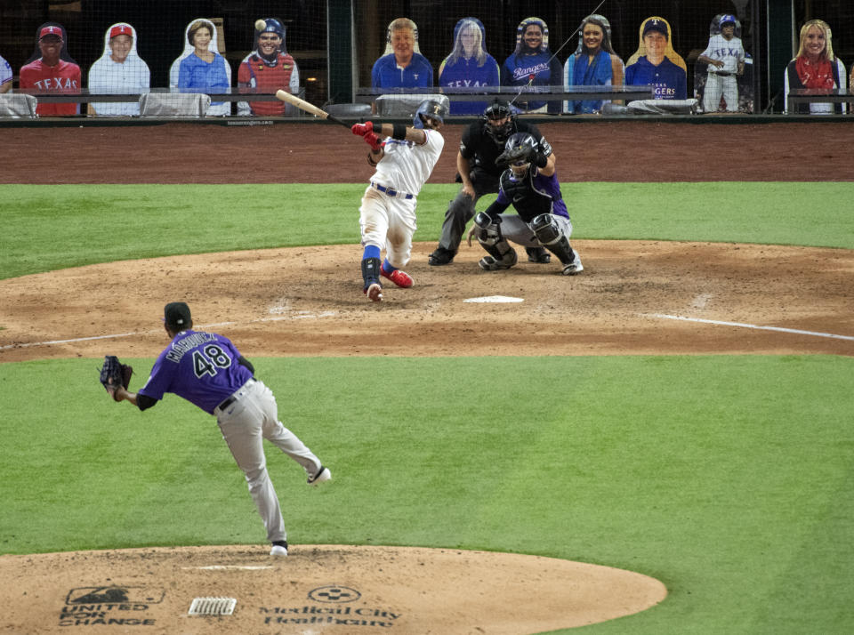 Texas Rangers' Rougned Odor follows through on an RBI-double off Colorado Rockies starting pitcher German Marquez that scored Danny Santana during the sixth inning of an opening day baseball game Friday, July 24, 2020, in Arlington, Texas. (AP Photo/Jeffrey McWhorter)