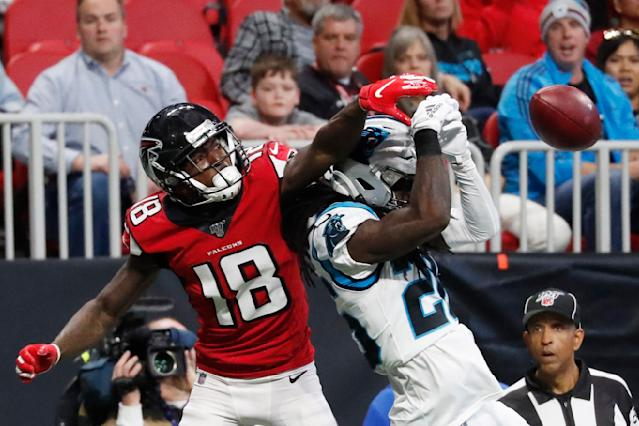 Atlanta Falcons wide receiver Calvin Ridley (18) misses the catch against Carolina Panthers cornerback Donte Jackson (26) during the first half of an NFL football game, Sunday, Dec. 8, 2019, in Atlanta. (AP Photo/John Bazemore)