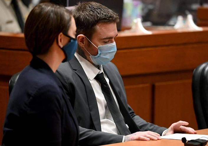 Kylr Yust and attorney Molly Hastings sit at the defense table after the judge informed Yust of the jury's sentencing recommendations. The jury in the Kylr Yust murder trial recommended a sentence of 15 years for voluntary manslaughter of Kara Kopetsky and a life sentence (30 years) for the second-degree murder of Jessica Runions at the Cass County Justice Center Friday, April 16, 2021. Sentencing is set for June 7.