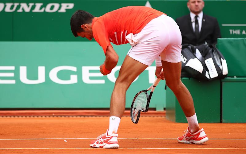 MONTE-CARLO, MONACO - APRIL 16: Novak Djokovic of Serbia smashes his racket in anger against Philipp Kohlschreiber of Germany in their second round match during day 3 of the Rolex Monte-Carlo Masters at Monte-Carlo Country Club on April 16, 2019 in Monte-Carlo, Monaco. (Photo by Clive Brunskill/Getty Images)