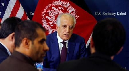 U.S. special envoy for peace in Afghanistan Zalmay Khalilzad talks with local reporters at the U.S. embassy in Kabul