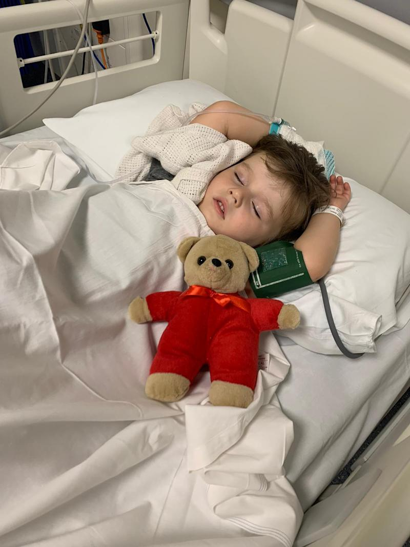 Lewis Wise (pictured) in a hospital bed after being bitten by a snake. His dad, Daniel, has issued a warning.