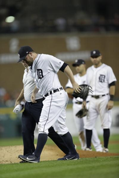 Detroit Tigers relief pitcher Alex Wilson is helped off the field being hit by a ball during the eighth inning of a baseball game against the Minnesota Twins, Saturday, Sept. 23, 2017, in Detroit. (AP Photo/Carlos Osorio)
