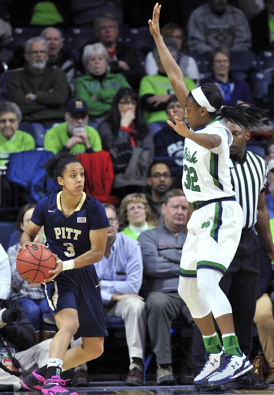 Pittsburgh guard Brianna Kiesel (3) looks to pass around Notre Dame guard Jewell Loyd (32) during the first half of an NCAA college basketball game Thursday, Feb. 26, 2015, in South Bend, Ind. (AP Photo/Joe Raymond)