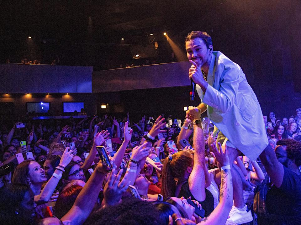 Singer MAX performs in front of a crowd at Official Lollapalooza Aftershow