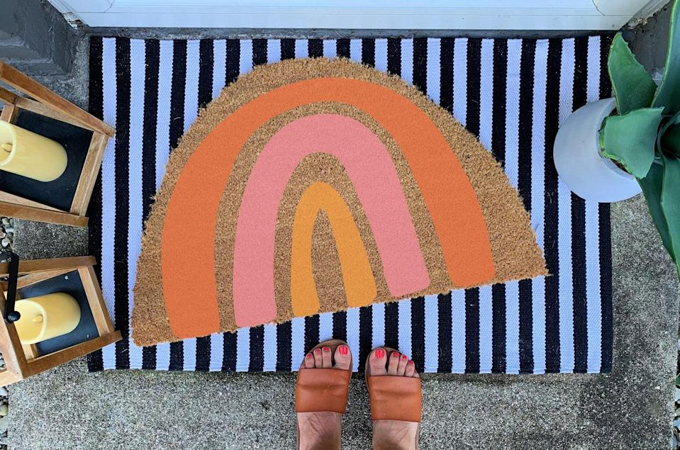 <p>This <span>Rainbow Customized Doormat</span> ($45 and up, originally $56 and up) is so joyful.</p>