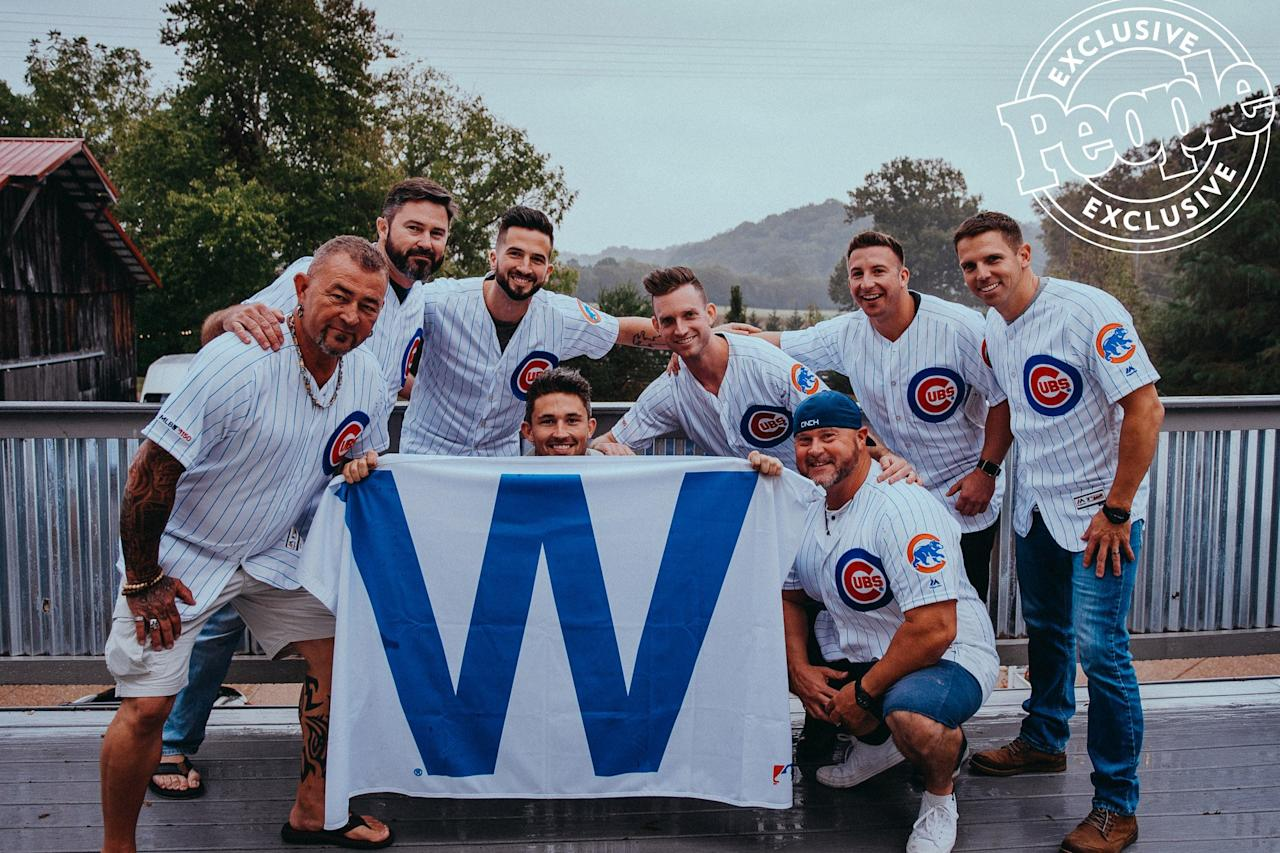 "The groom's party huddles up for a pre-wedding hang in custom Chicago Cubs jerseys honoring Ray's passion for the team. (He threw out a first pitch at a 2017 game.)  Best man C.J. Russell (in a cap) ""is the closest thing I have to a brother,"" Ray, 31, said. ""I picked my five groomsmen by what I felt were the men that shaped me throughout the years."" Ray's dad, Jerry (left), also got to hang out with the guys."