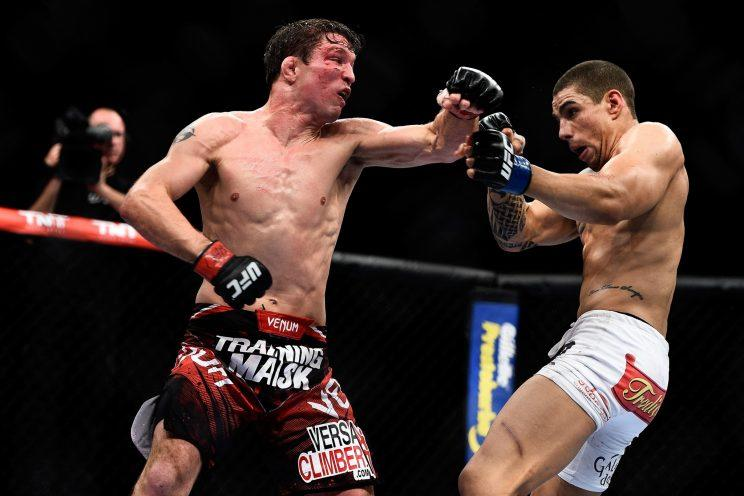 Darren Elkins punches Lucas Martins during their featherweight bout at UFC 179. (Getty)
