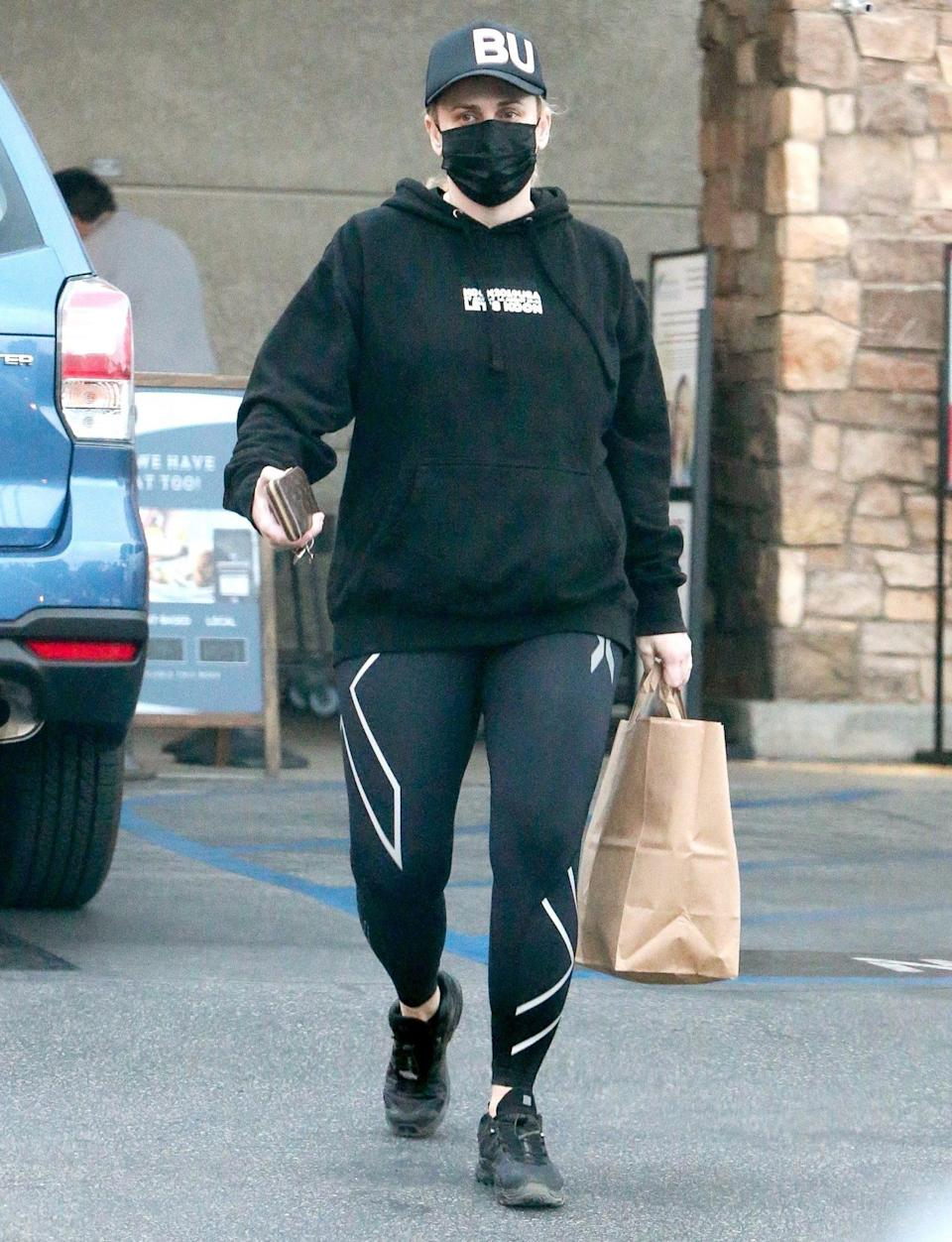 <p>Rebel Wilson grabs some goodies from the grocery store in Los Feliz, California, on Sunday.</p>