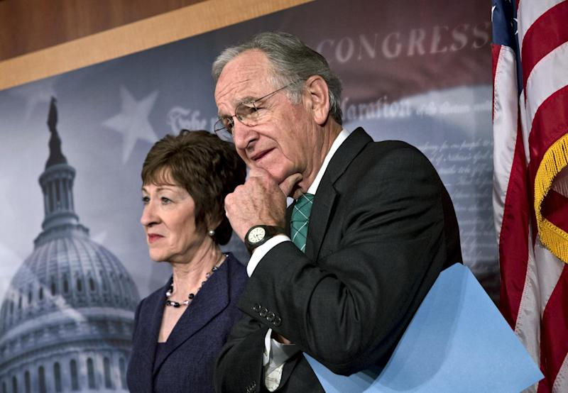 Sen. Tom Harkin, D-Iowa, right, chairman of the Health, Education, Labor, and Pensions Committee, stands with Sen. Susan Collins, R-Maine, just after the Senate cleared a major hurdle and agreed to proceed to debate a bill that would prohibit workplace discrimination against gay, bisexual and transgender Americans, at the Capitol in Washington, Monday, Nov. 4, 2013. The bipartisan vote increases the chances that the Senate will pass the bill by week's end, but its prospects in the Republican-led House are dimmer. (AP Photo/J. Scott Applewhite)