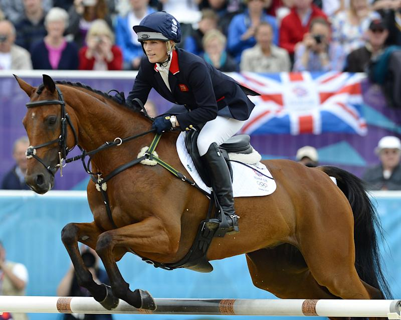 Great Britain's Zara Phillips rides on her horse High Kingdom as they take part in the Jumping Phase of the Eventing competition of the 2012 London Olympics at the Equestrian venue in Greenwich Park, London, on July 31, 2012. AFP PHOTO / ADRIAN DENNIS (Photo credit should read ADRIAN DENNIS/AFP/GettyImages)