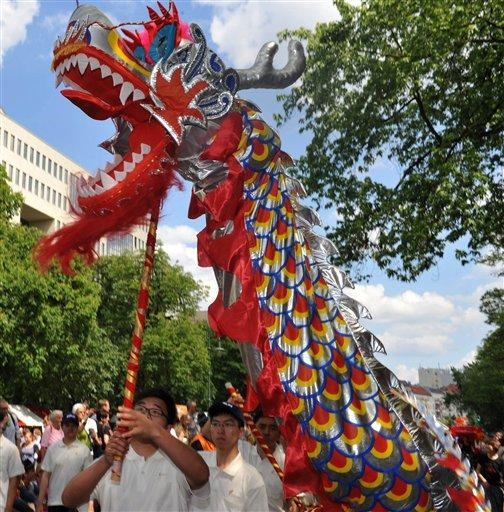 Participants with a dragon march at the annual Carnival of Cultures parade in Berlin, Sunday, May 27, 2012. Thousands of people attended the festival with costumes from all over the world. (AP Photo/dapd/Paul Zinken)