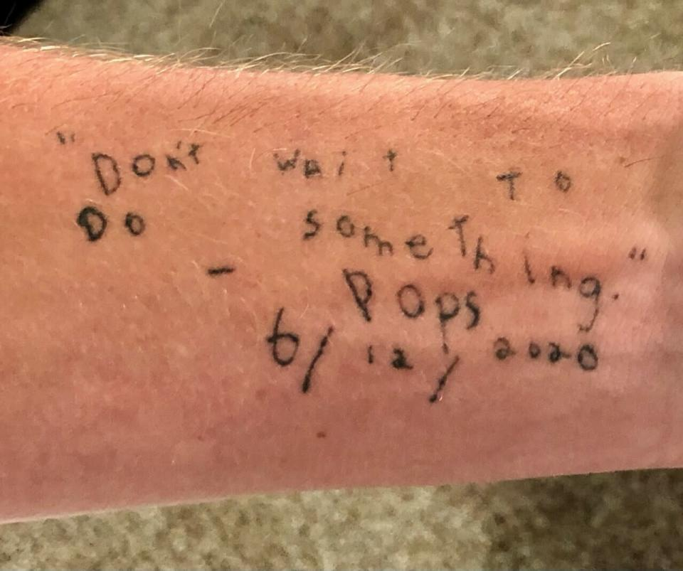 """This photo provided by Sam Bennett shows a tattoo of the last words spoken to him by his father, who suffers from Alzheimer's and also wrote the words down as best he could: """"Don't wait to do something. - Pops 6/12/2020."""" Bennett, a Texas A&M golfer who earned a spot in the PGA Tour, looks at these words before every shot. (Sam Bennett via AP)"""