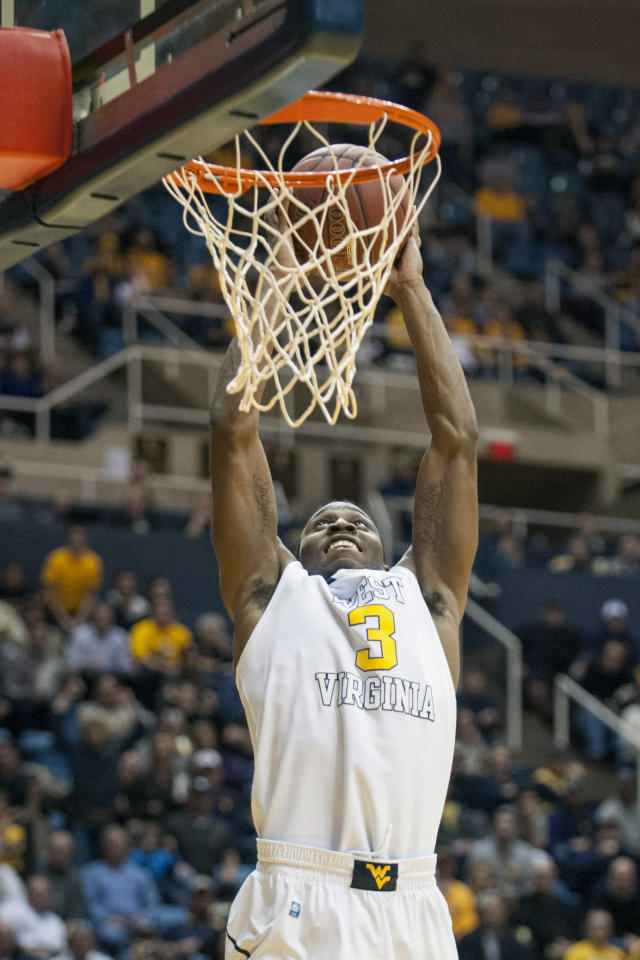 West Virginia's Juwan Staten (3) dunks during the second half of an NCAA college basketball game against Iowa State, Monday, Feb. 10, 2014, in Morgantown, W.Va. West Virginia won 102-77. (AP Photo/Andrew Ferguson)