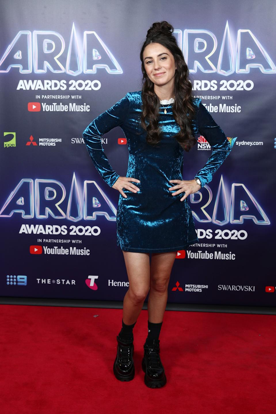 Amy Shark wears a blue crushed velvet mini dress on the red carpet at the 2020 ARIA Awards at The Star on November 24, 2020 in Sydney, Australia.