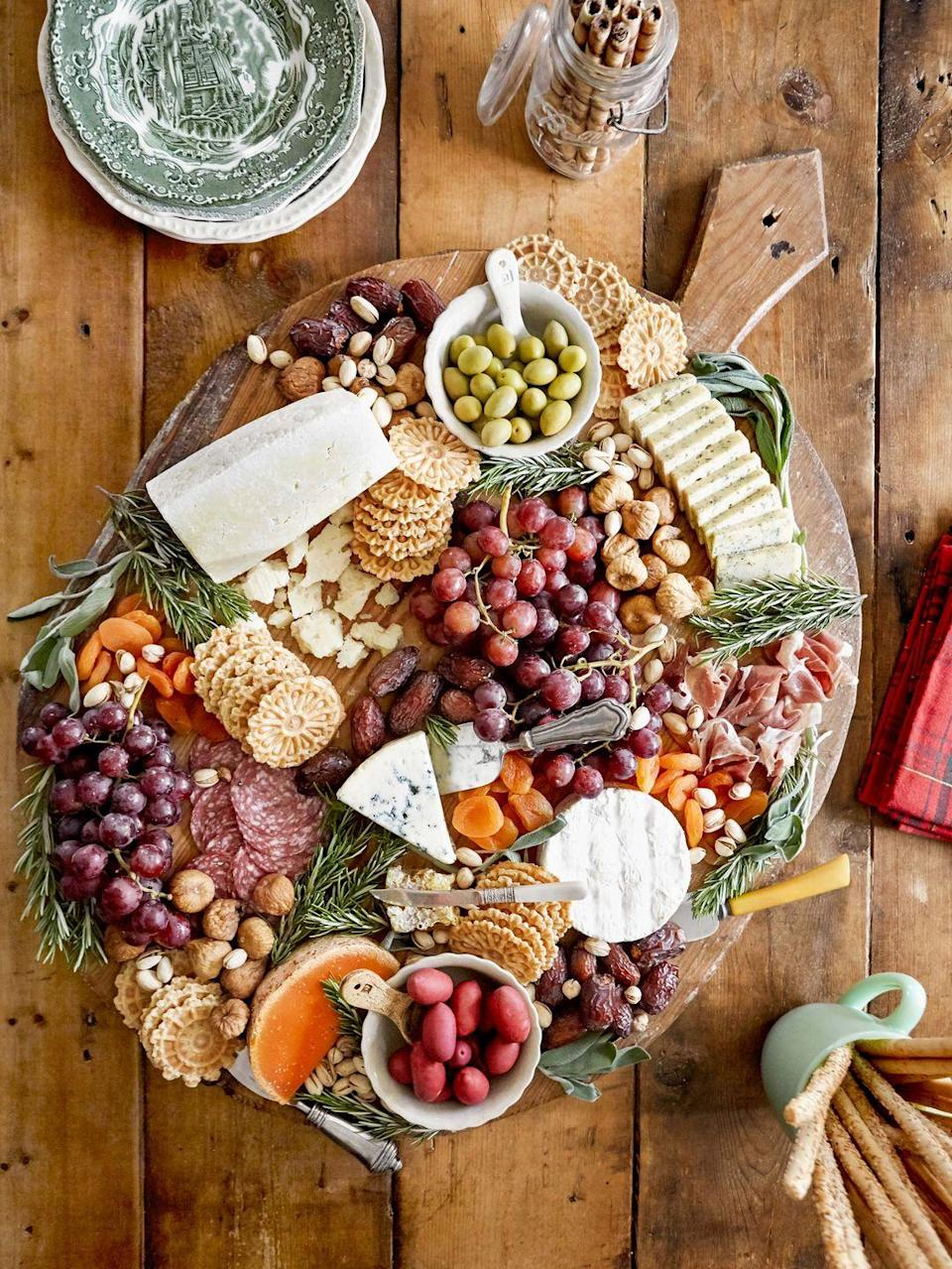 """<p>Set this out around lunchtime and let the family graze while waiting for dinner.</p><p><strong><a href=""""https://www.countryliving.com/food-drinks/a34931277/cheeseboard-how-to/"""" rel=""""nofollow noopener"""" target=""""_blank"""" data-ylk=""""slk:Get the recipe"""" class=""""link rapid-noclick-resp"""">Get the recipe</a>.</strong> </p>"""