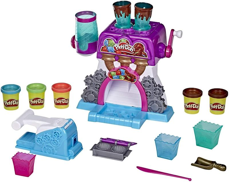 """It's a """"<a href=""""https://amzn.to/2Hm9gOn"""" target=""""_blank"""" rel=""""noopener noreferrer"""">candy crankin' machine</a>""""&mdash; kids can use this set to make their ownpretend peanut butter cups and chocolate bars with Play-Doh. It's definitely a <i>sweet</i> gift. <a href=""""https://amzn.to/2Hm9gOn"""" target=""""_blank"""" rel=""""noopener noreferrer"""">Find it for $25 at Amazon</a>."""