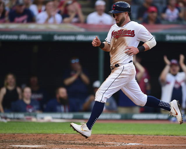 Cleveland Indians' Jason Kipnis scores on a sacrifice fly by Tyler Naquin during the fifth inning of the team's baseball game against the Detroit Tigers, Thursday, July 18, 2019, in Cleveland. (AP Photo/David Dermer)
