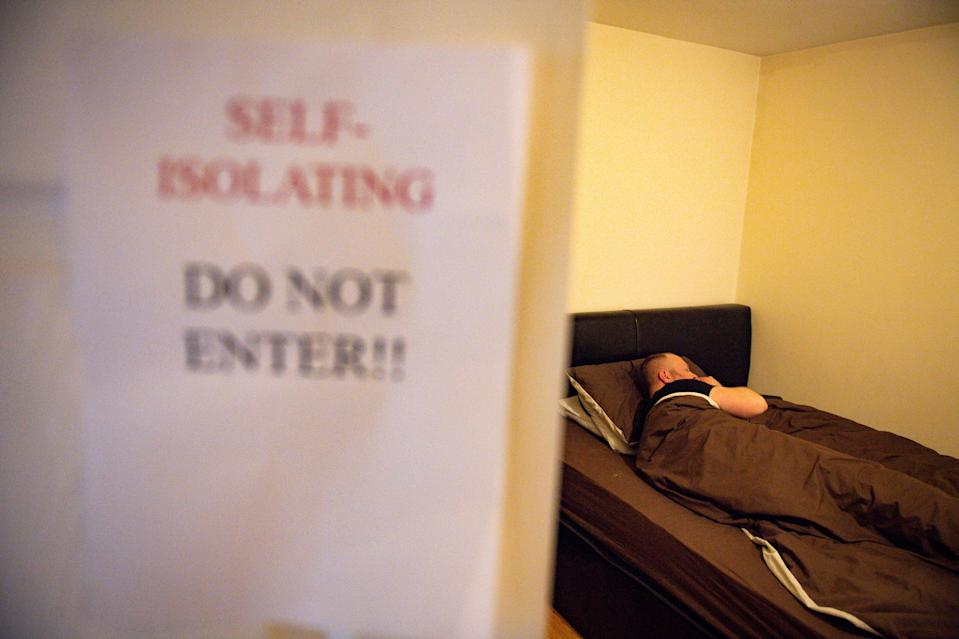 A self-isolation sign left outside a property (Jacob King/PA) (PA Wire)