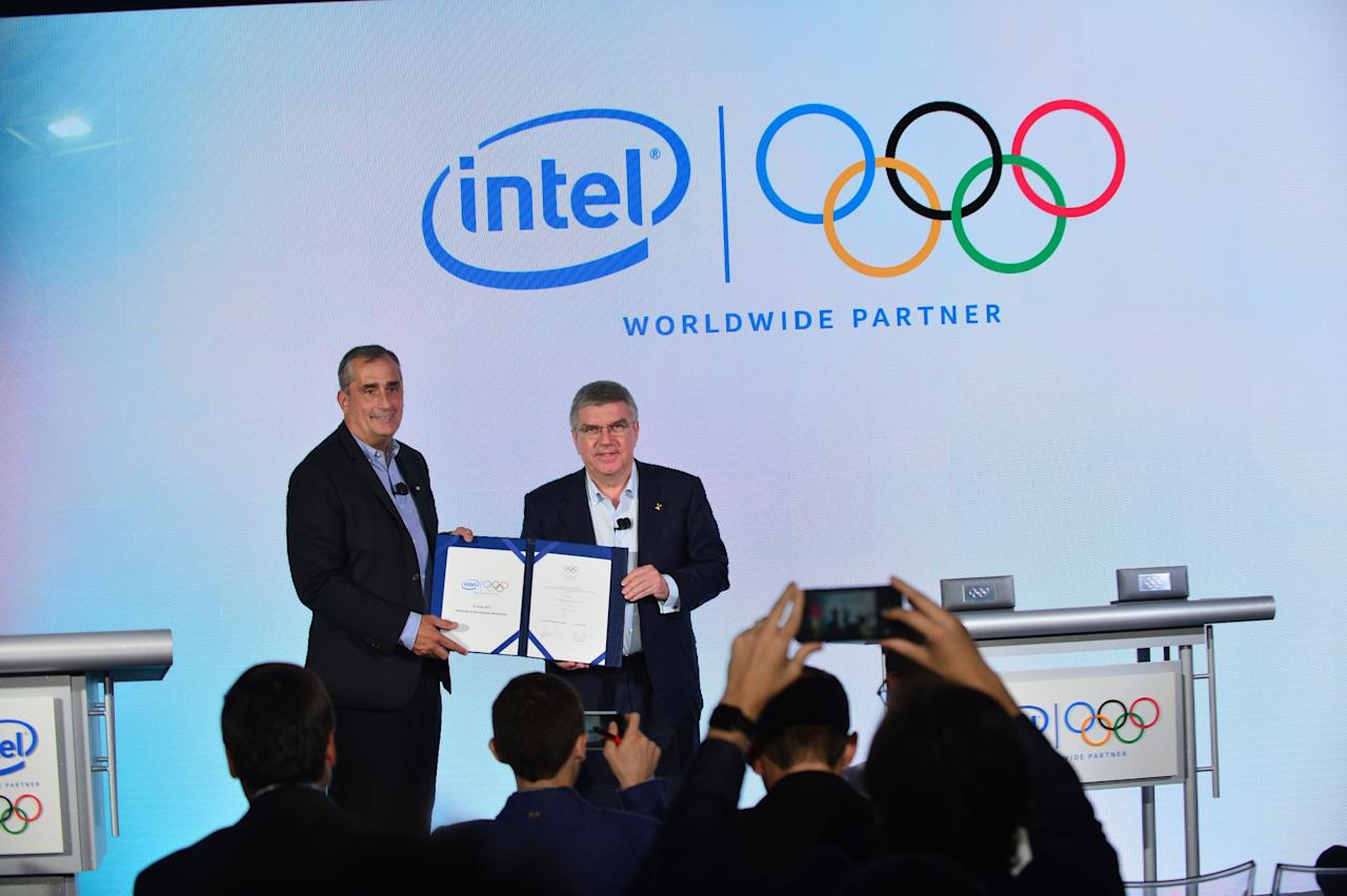 Intel CEO Brian Krzanich and IOC President Thomas Bach have sealed a deal to use new technology at upcoming Olympic Games.
