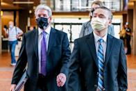 Former Minneapolis Police officer Tou Thao and his attorney Robert Paule arrive at the Hennepin County Government Center, ahead of a courthouse appearance, on July 21, 2020 in Minneapolis. (Brandon Bell / Getty Images file)