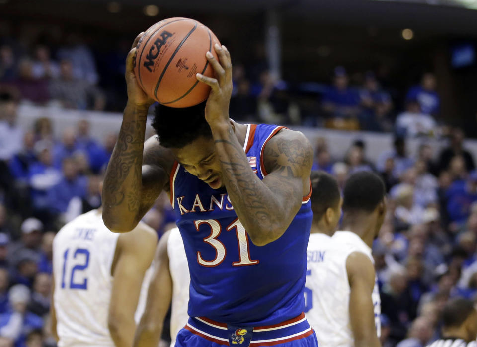 Kansas's Jamari Traylor reacts after missing a shot during the first half of an NCAA college basketball game against the Kentucky, Tuesday, Nov. 18, 2014, in Indianapolis. (AP Photo/Darron Cummings)