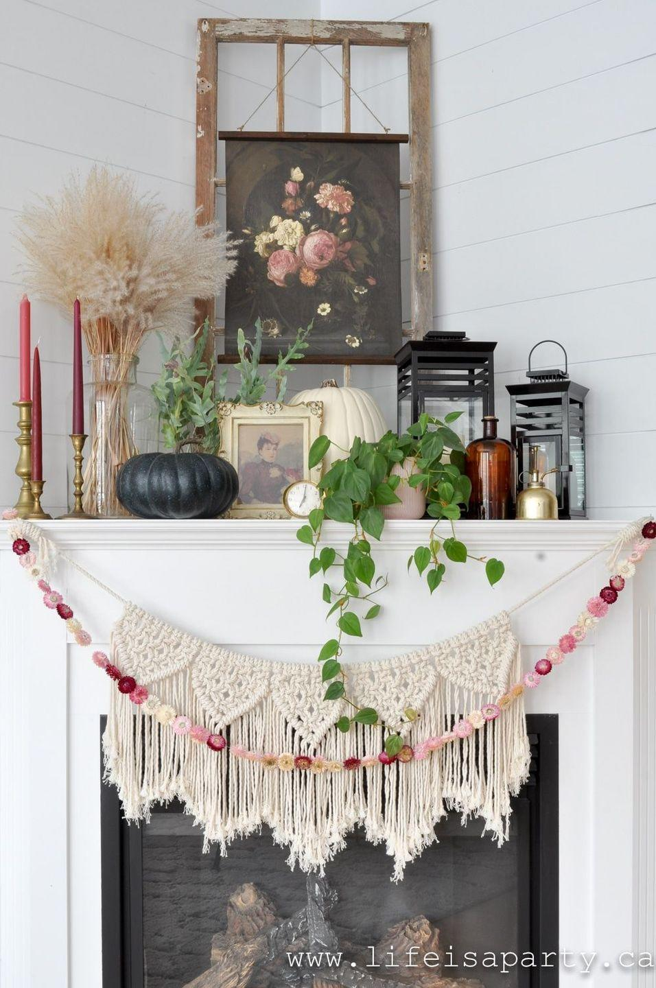 """<p>This tutorial will show you how to take a free image from an art collection and turn it into a fall-ready masterpiece made for your mantel.</p><p><strong>Get the tutorial at <a href=""""https://www.lifeisaparty.ca/boho-fall-mantel-decor-ideas/"""" rel=""""nofollow noopener"""" target=""""_blank"""" data-ylk=""""slk:Life Is a Party"""" class=""""link rapid-noclick-resp"""">Life Is a Party</a>.</strong></p><p><a class=""""link rapid-noclick-resp"""" href=""""https://go.redirectingat.com?id=74968X1596630&url=https%3A%2F%2Fwww.walmart.com%2Fsearch%2F%3Fquery%3Dtwine&sref=https%3A%2F%2Fwww.thepioneerwoman.com%2Fhome-lifestyle%2Fcrafts-diy%2Fg36891743%2Ffall-mantel-decorations%2F"""" rel=""""nofollow noopener"""" target=""""_blank"""" data-ylk=""""slk:SHOP TWINE"""">SHOP TWINE</a></p>"""